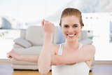 Sporty woman stretching hands in fitness studio