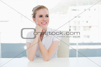 Thoughtful businesswoman sitting office desk