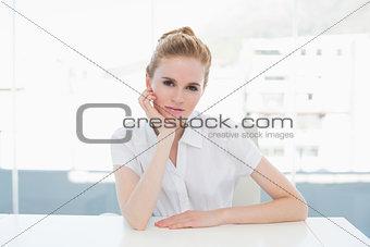 Portrait of businesswoman sitting at office desk