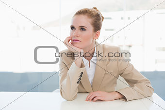 Thoughtful businesswoman sitting in office