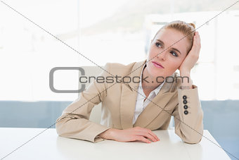 Thoughtful businesswoman sitting at office desk