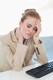 Businesswoman with neck pain at office desk