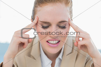 Close up of businesswoman suffering from headache