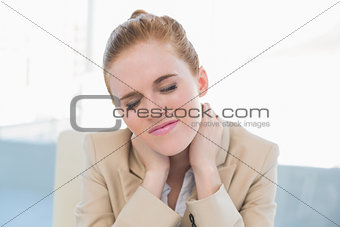 Close up of businesswoman with neck pain