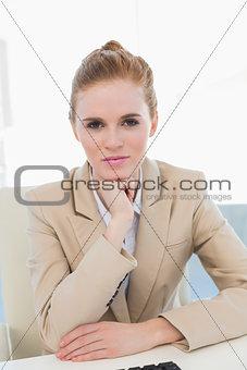 Portrait of an elegant businesswoman at office desk