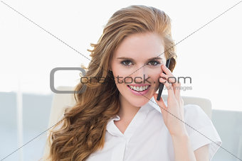 Portrait of businesswoman using cellphone in office