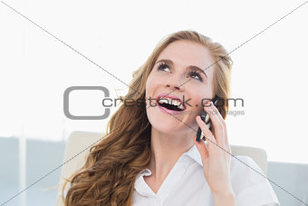Close up of cheerful businesswoman using cellphone