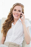 Portrait of young businesswoman using cellphone