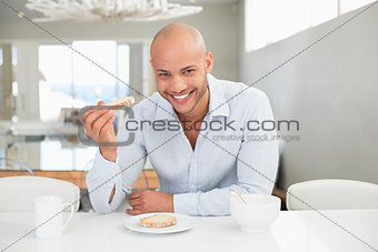 Young man having breakfast at home