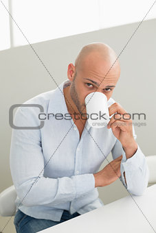 Young man drinking coffee at home