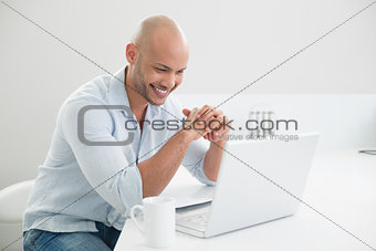 Casual man using laptop at home