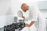 Young man preparing food in the kitchen
