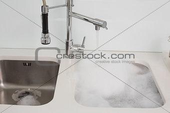 Close up of foam in kitchen sink