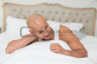 Close up of a man resting in bed