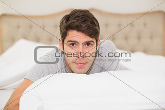 Close up portrait of a man resting in bed