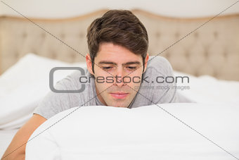 Close up of a young man resting in bed