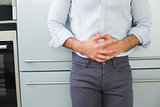 Mid section of a man suffering from stomach pain