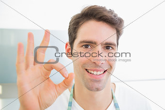 Close up of a smiling man gesturing okay sign