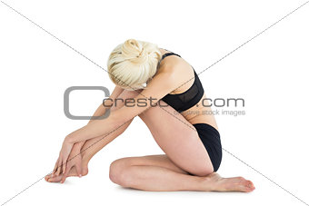 Toned blond sitting over white background