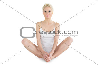 Toned young woman doing the butterfly stretch