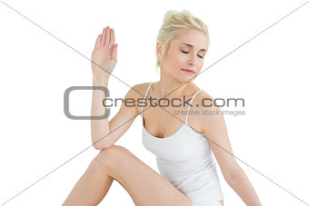 Toned woman in Ardha Matsyendrasana position