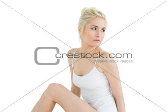 Thoughtful young woman in tank top