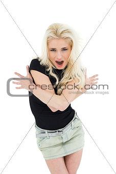 Beautiful casual young blond shouting