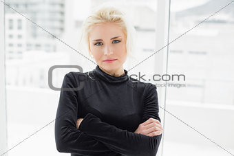 Beautiful casual woman in black with hands folded