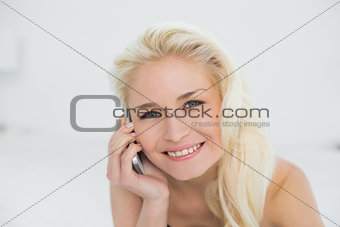 Close up of relaxed woman using mobile phone