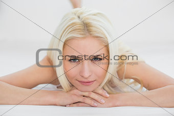 Close up of a smiling beautiful blond in bed