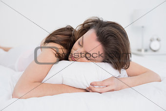 Close up of pretty woman sleeping in bed