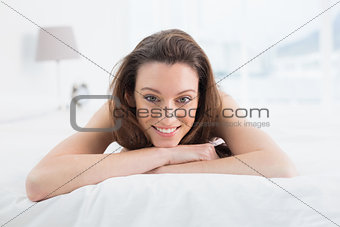 Close up portrait of pretty woman resting in bed