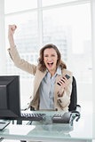Portrait of an elegant businesswoman cheering in office