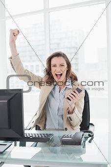 Portrait of an elegant businesswoman cheering in office