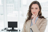 Elegant smiling businesswoman standing in office
