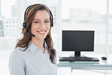 Portrait of businesswoman wearing headset in office