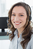Businesswoman wearing headset in front of computer