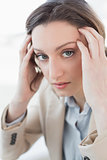 Close up portrait of businesswoman suffering from headache