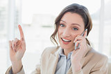 Smiling elegant businesswoman using mobile phone
