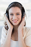 Close up portrait of casual woman enjoying music