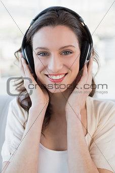 Close up portrait of casual woman enjoying music