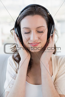 Close up of relaxed casual woman enjoying music