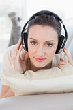 Close up of a relaxed casual woman enjoying music on sofa
