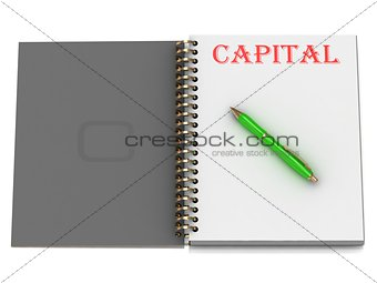 CAPITAL inscription on notebook page