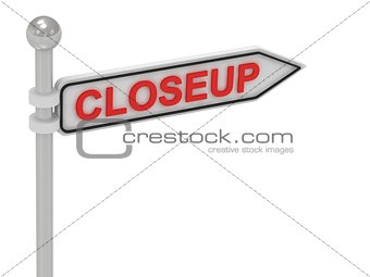 CLOSEUP arrow sign with letters