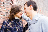 Portrait of love couple looking happy against wall background