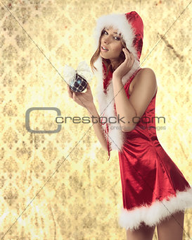attractive xmas woman with bauble