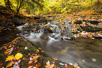 Beautiful waterfall  cascade and fall foliage