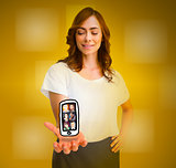 Cheerful woman levitating a mobile phone picture