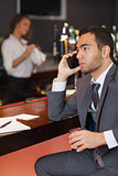 Serious businessman having a phone call